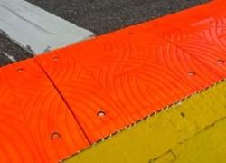 FIA orange sausage kerb removed at top of Eau Rouge